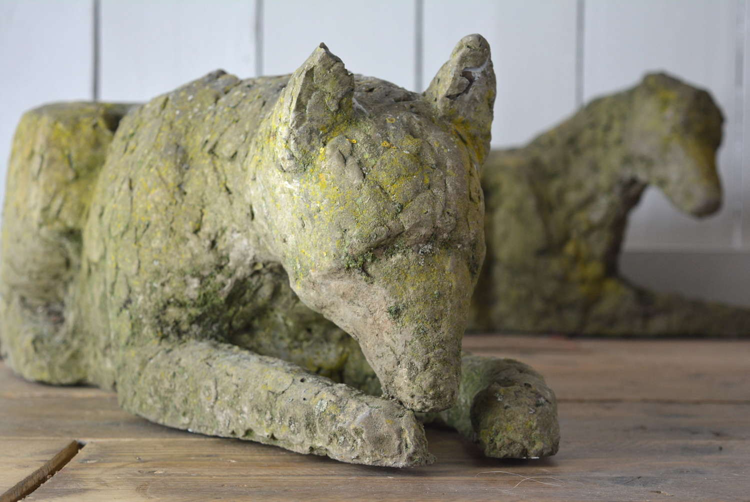 PAIR OF HAND HONED STONE DOGS
