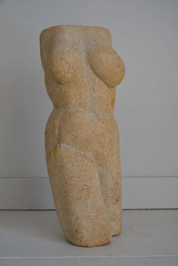 STONE CARVED FIGURE